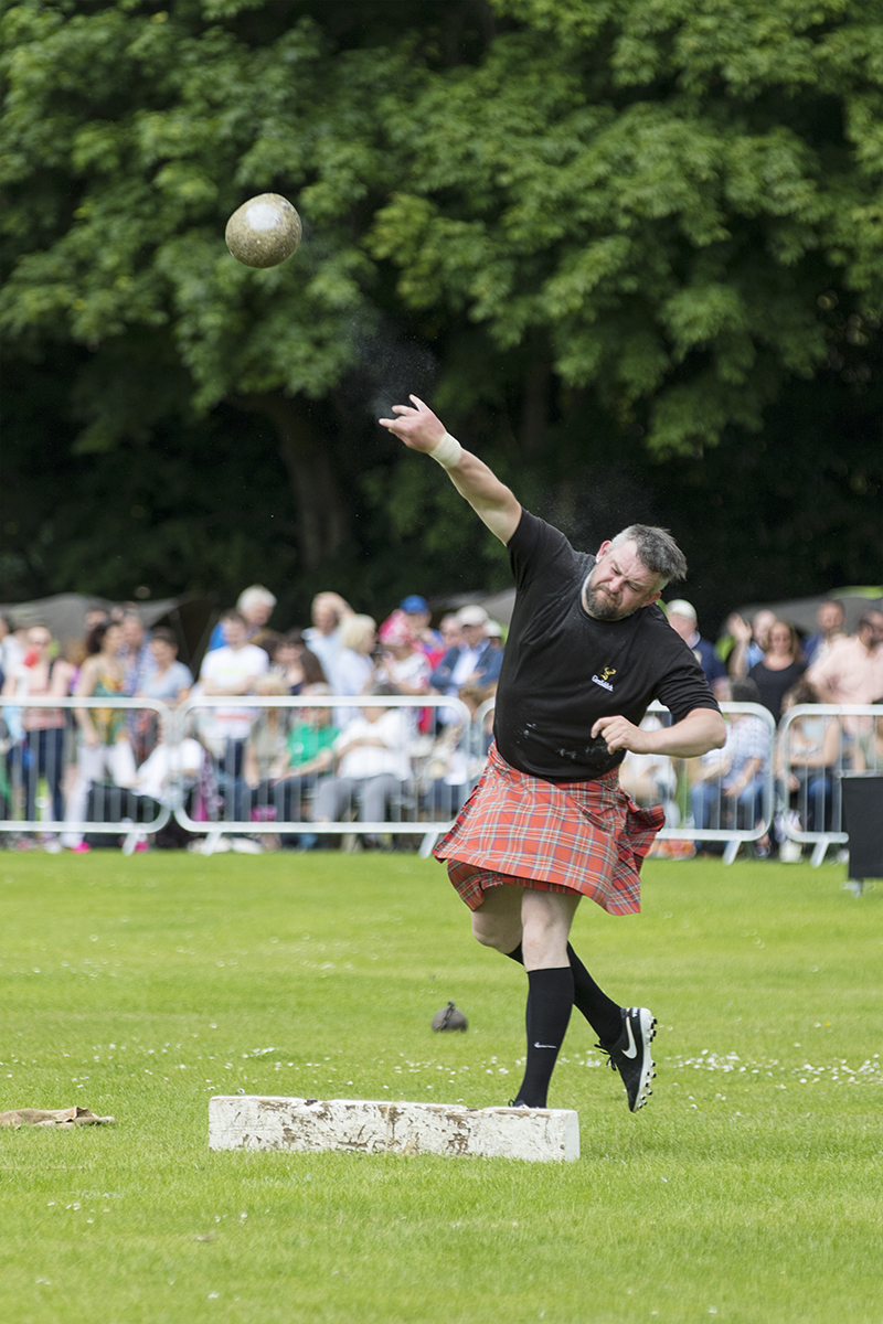 Stone Put at a Highland Games event in Scotland
