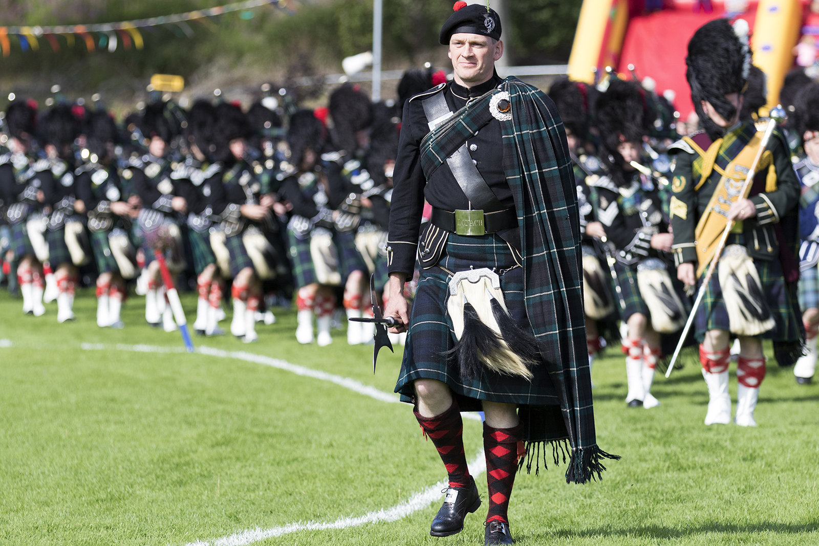 Massed Pipe Band at a Highland Games event in Scotland.