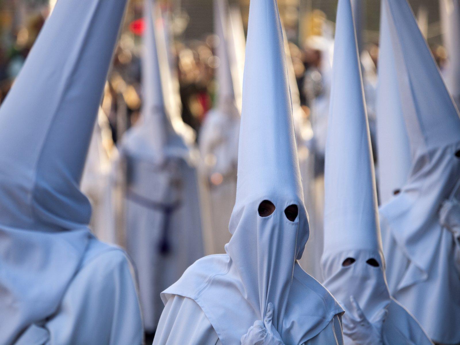 Nazarenos during Semana Santa in Malaga, Spain