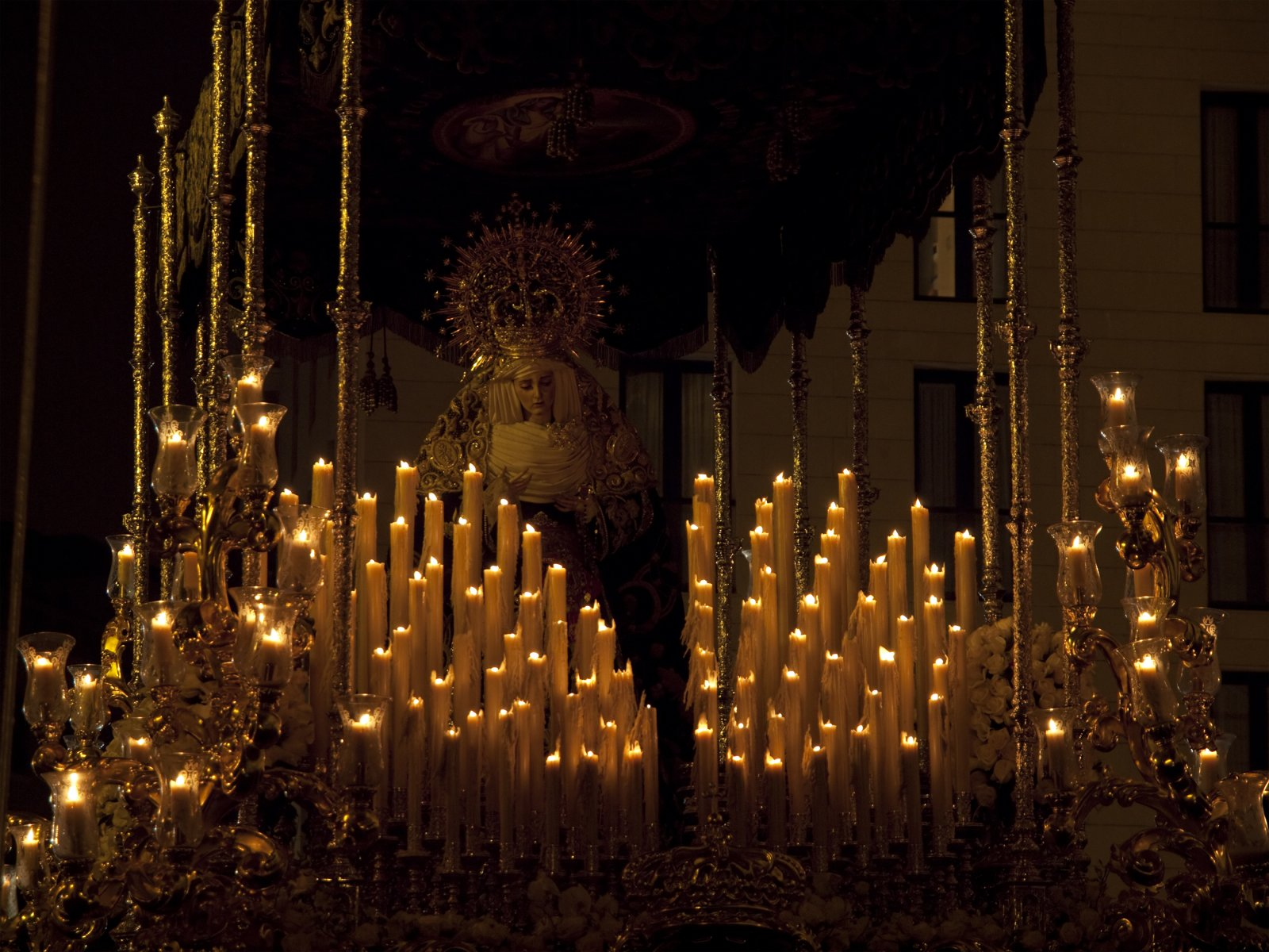Candlelit Sculpture of the Virgin Mary